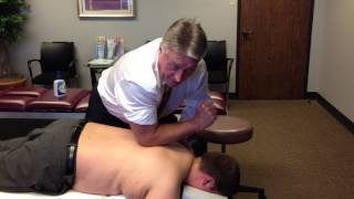 Your Houston Chiropractor Dr Gregory Johnson Doing Deep Soft Tissue Work On Severe Muscle Spasm Pati