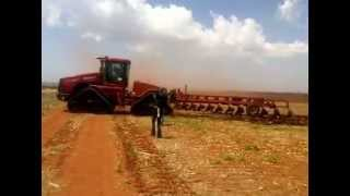 Big tractor ploughing