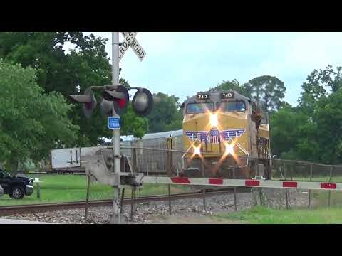 Union Pacific 7413 Leads an Autorack Train in Old Town Spring, TX on 5/24/16