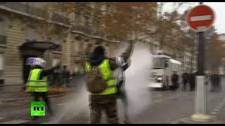 Police unleash water cannon on Yellow Vests protesters in Paris