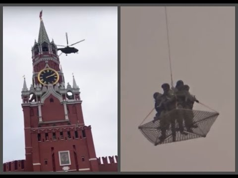 Armed soldiers flying near Kremlin in net suspended from helicopter… Wait, what??