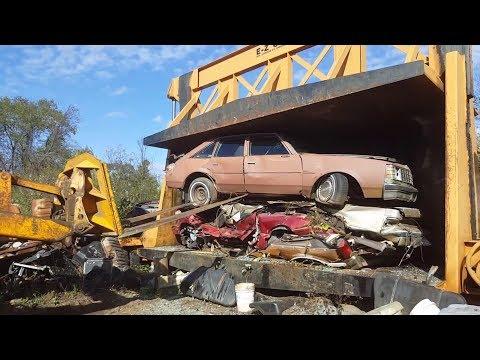 Car crusher crushing cars 50 buick century salon