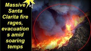 Massive Santa Clarita fire rages, evacuations amid soaring temps™