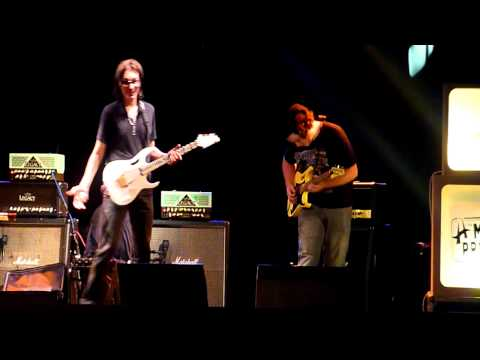 Steve Vai jamming with members selected from the audience at his guitar workshop