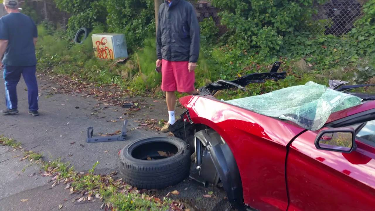 Epic car crash mustang soft top Ballard WA guy walked away