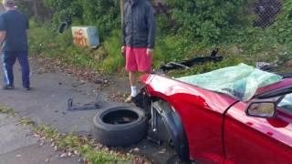 Epic  car crash mustang soft top Ballard WA guy walked away
