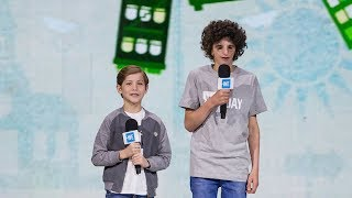 Jacob Tremblay and Nathaniel Newman speak together onstage at WE Day Seattle