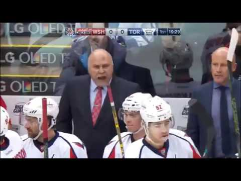 2 coaches 2 objects 2 different reactions (soccer vs hockey)