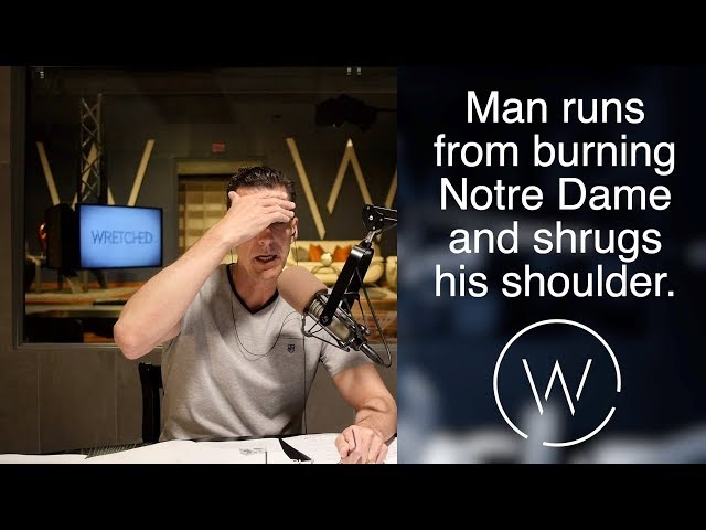Man runs from burning Notre Dame and shrugs his shoulder.