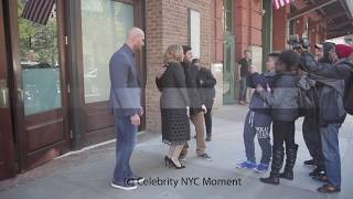 Adele takes photos with fans in NYC