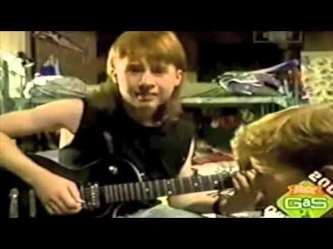 Budnick plays guitar
