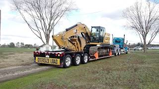 loading-up-a-new-cat-320gc-excavator