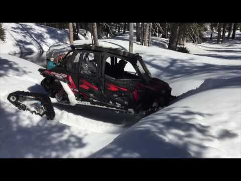 rzr-xp-turbo-with-snow-tracks-mountain-climb