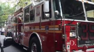 BIG MORON PREVENTS FDNY TOWER LADDER 35 FROM COMPLETING EMERGENCY CALL BY LEAVING CAR DOUBLE PARKED.