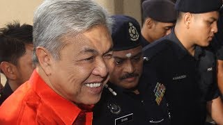 Zahid brought to court to face multiple charges