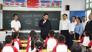 How does Xi Jinping promote education in less developed regions?