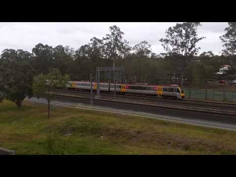 Queensland Rail 6 car IMU express through Carseldine station.