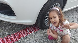 KOKA KOLA KUTULARINI EZDİK, crushes coca cola with car