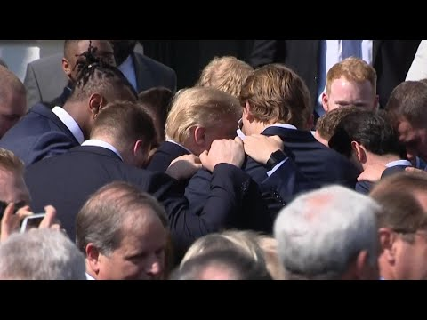 Trump Gets Impromptu Prayer Huddle from Alabama Football Team