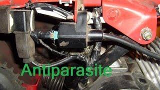 Remplacement anti parasite sur moteur 2 temps