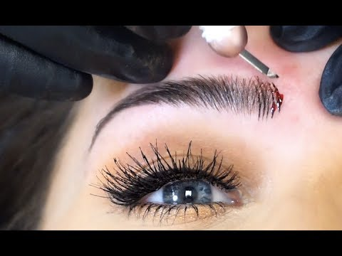 GETTING MY EYEBROWS MICROBLADED! | Carli Bybel