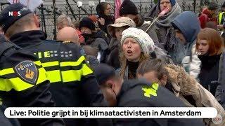 LIVE: Politie grijpt in bij klimaatactivisten in Amsterdam