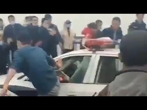 Violent protests erupt in China as Hubei natives blocked from leaving from YouTube · Duration:  1 minutes 15 seconds