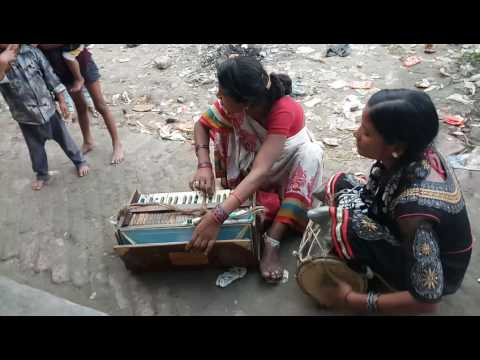Mother and daughter sing a song on road.