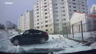 Driver Reverses Away From Sliding Car