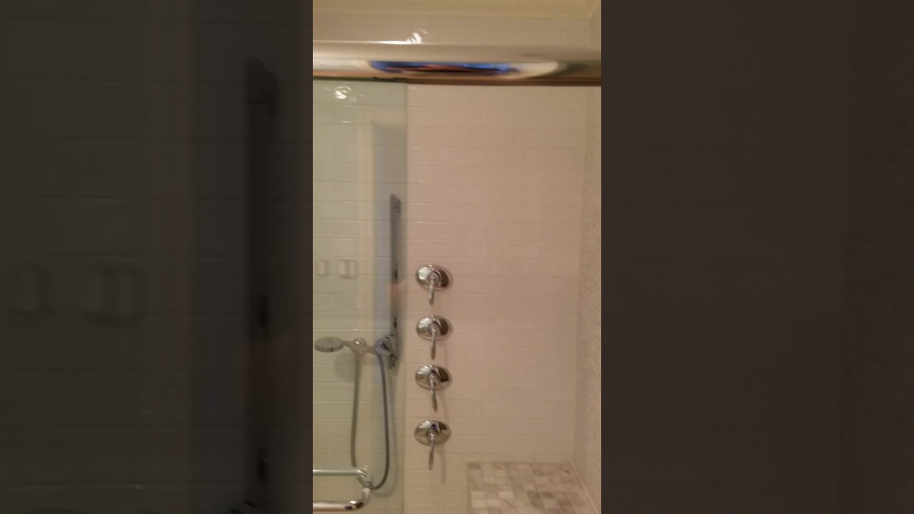 Standing shower and bench with fully adjustable shower heads and ...