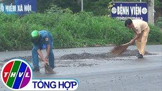 THVL | CSGT cùng người dân dọn đá rơi trên quốc lộ