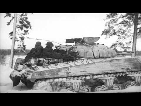 United States Army infantrymen and M4 Sherman tanks move across snow covered fiel...HD Stock Footage