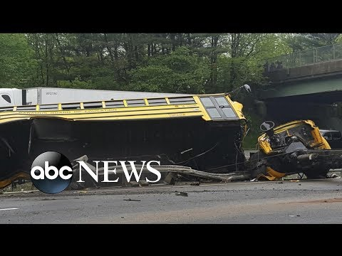 2 killed, several injured after school bus collides with dump truck