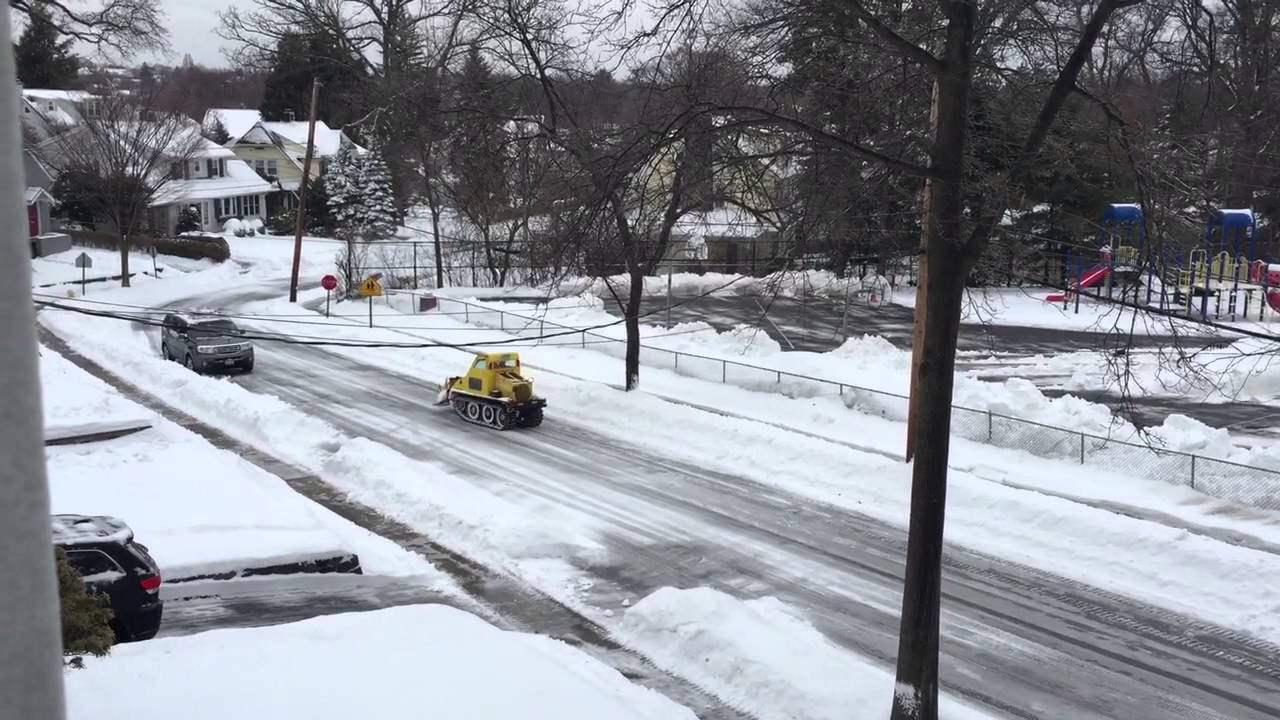 Bombardier sidewalk plow tearing up street!