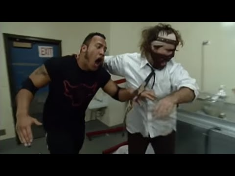 The Rock and Mankind use popcorn for something besides snacking: Halftime Heat, Jan 31, 1999