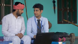 Young Indian farmer talking to a bank employee - Loan for farms. Village life