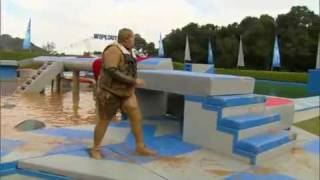 LMAO: Fat Gay Man With An Under Bite Busts His Azz During Obstacle Game Show!