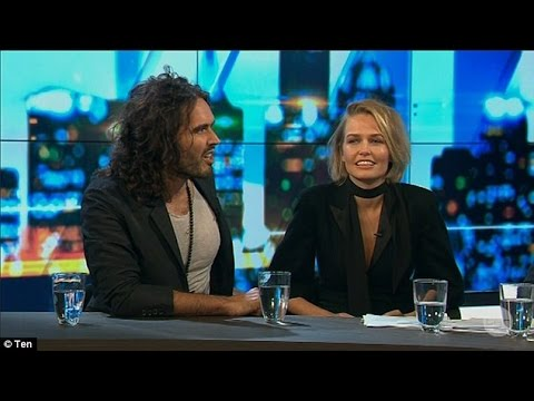 Lara Bingle struggles to get a word in with fast-talking Russell Brand who labels her 'racist'