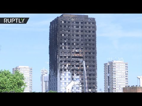 RAW: Grenfell Tower still smoldering day after fire kills 17
