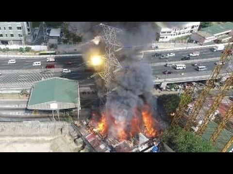 Blaze tips transmission tower toward highway