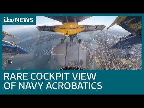 US Navy planes show off stunning close-quarters coordination | ITV News