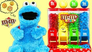 Feeding Sesame Street Cookie Monster with M&M Candy Dispenser & Surprise Toys Opening!