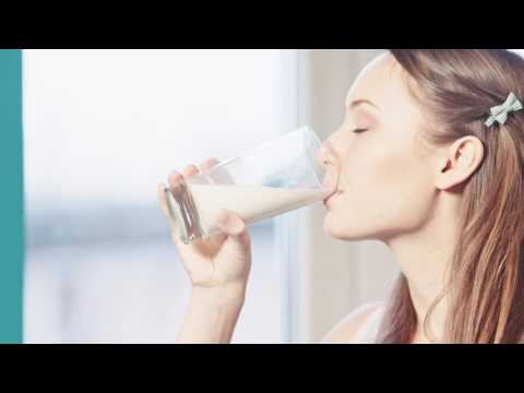 woman eating healthy breakfast cereals with milk and drinking orange juice filmed in 4k dci resoluti
