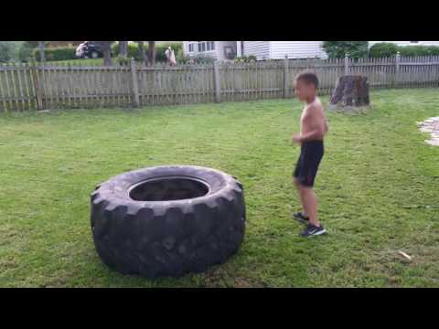 7 year old flipping tire