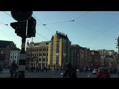 Rokin to dam .street drive view Amsterdam
