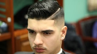 Skin fade comb over(styled with layrite pomade)