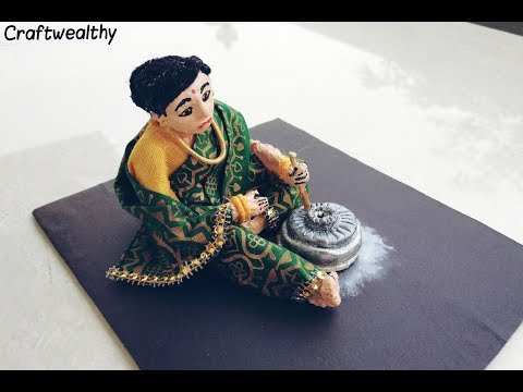 DIY paper mache woman with mill