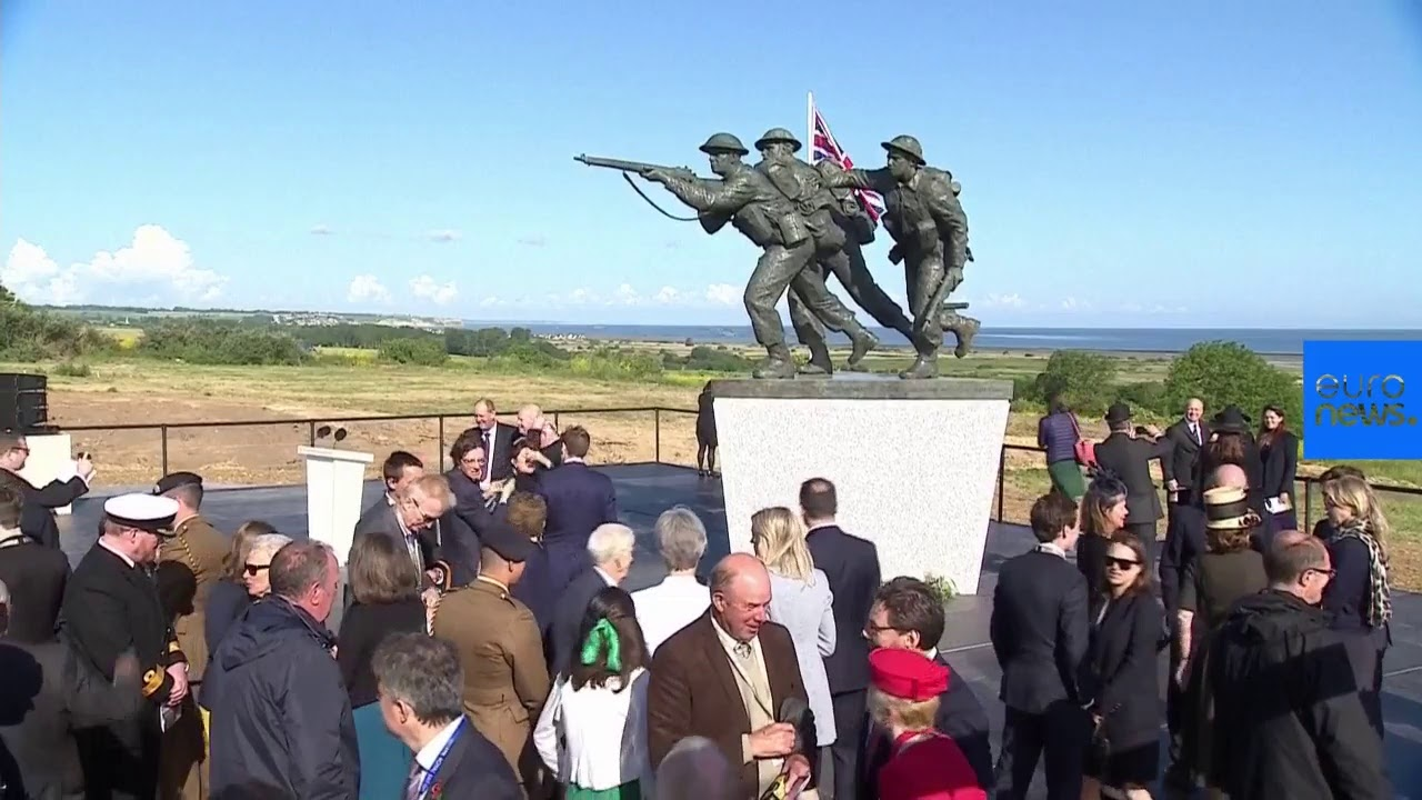 D-Day: May and Macron in France to mark 75th anniversary