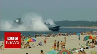 MILITARY HOVERCRAFT SHOCKS RUSSIAN SUNBATHERS - BBC NEWS