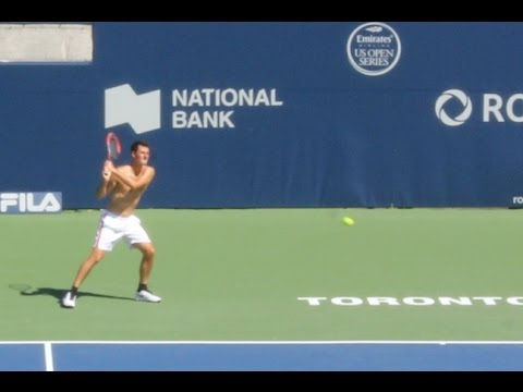 Bernard Tomic practice's before the start of the 2016 Rogers Cup